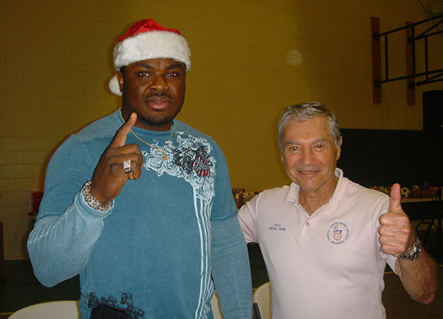 Heavyweight contender Samuel Peters and Ron Ross giving out Christmas gifts to kids at Deerfield Beach Boys Club, 2010